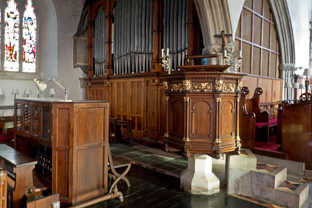 The pulpit and organ in the church of St Michael & All Angels, Torrington
