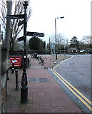 SS7597 : Black signpost at the SE end of Orchard Street, Neath by Jaggery