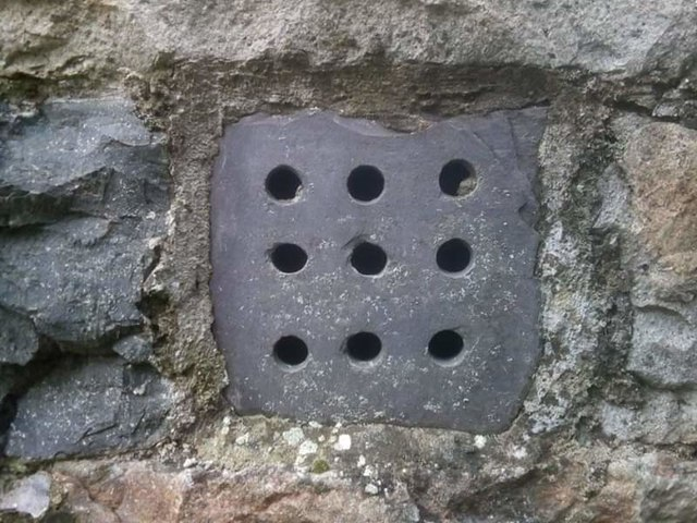 A slate ventilation grille at church, Llanllechid