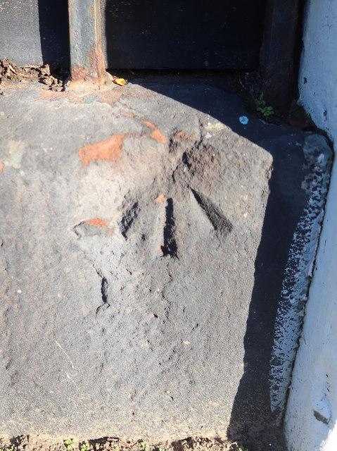 Damaged rivet bench mark in Adelaide Terrace, Crosby