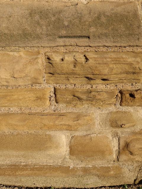 Weathered bench mark on St Nicholas, Blundellsands