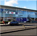 ST3486 : Names above an entrance to Tesco Extra in Newport Retail Park by Jaggery