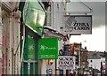 TQ5839 : Shop signs on High Street - Tunbridge Wells, Kent by Ian Cunliffe