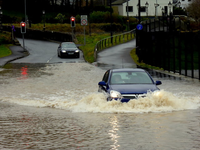 Risking it through the flooded road, Campsie