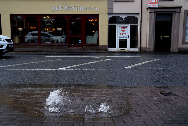 Water bursting through a manhole cover, Omagh