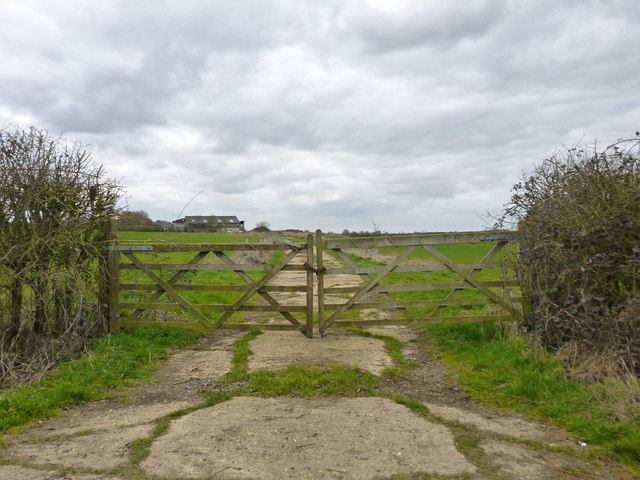Gated concrete road to barns