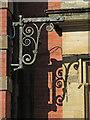 NZ2563 : Old hoist on Milburn House, Side , NE1 by Mike Quinn