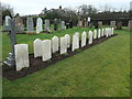 NX9875 : Commonwealth war graves, from the north by Christine Johnstone