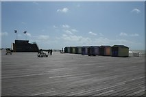 TQ8109 : Beach huts on the pier by DS Pugh