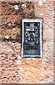 NY5633 : Benchmark bracket on St Peter's Church by Luke Shaw