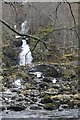 NN6947 : Allt dà Ghob: falls and bridge by Richard Webb