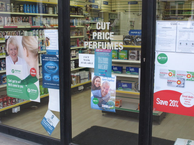 """Pharmacy sign """"Face mask available"""" in coronavirus pandemic"""