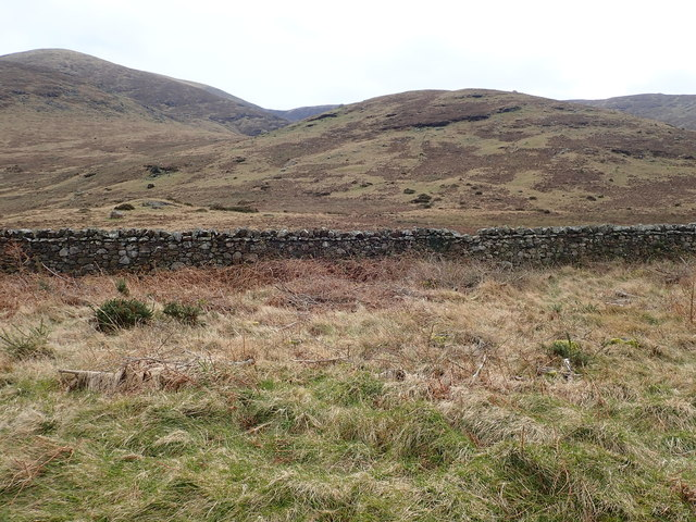 A section the Tollymore Demesne Wall with the High Mournes in the background