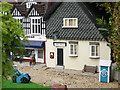 SU9391 : The Swan Pub and a miniature RAC telephone box at Bekonscot Model Village by David Hillas