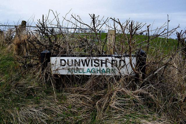 Road sign in hedge along Dunwish Road