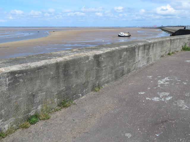 Promenade wall, Meols Parade, and a bench mark