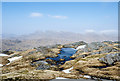 NM9091 : Lochan near summit area of Carn Mòr by Trevor Littlewood