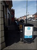 SZ0894 : Ensbury Park: social distancing notice outside the Co-Op by Chris Downer