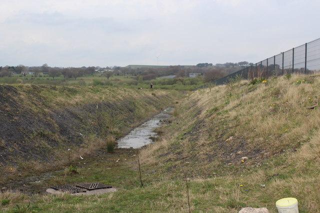 Drain by perimeter fence, Plateau 1