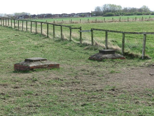 Two Raised Manholes near Brier Dene Farm, Whitley Bay