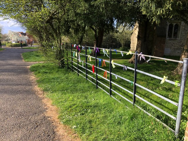 Ribbons of hope on the church fence