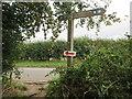 TF8344 : Norfolk  Coast  Path  enters  field by Martin Dawes