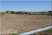 J3633 : View North-eastwards across ploughed land to houses on the A50 (Castlewellan Road) by Eric Jones