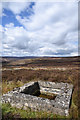 NZ0732 : Concrete tank on heather moorland by Trevor Littlewood