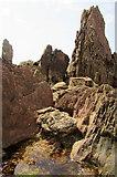 SX6643 : Rocks near Long Stone by Derek Harper