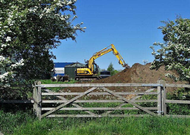 Digger at work on Coulman Road Industrial Estate