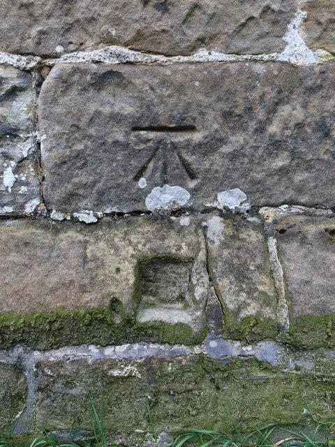 Bench mark on St Mary's church tower, Kilburn