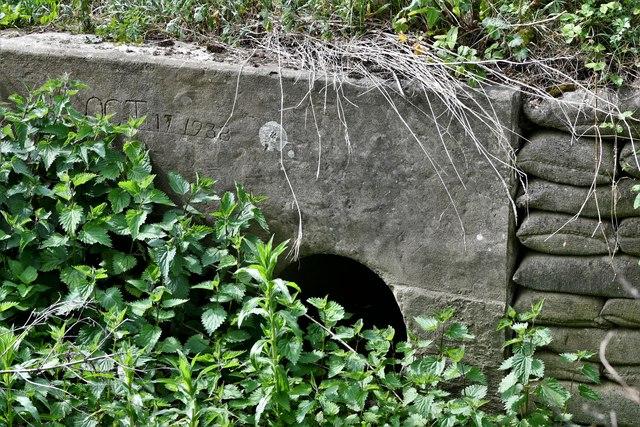 Tannington: Dated drainage culvert