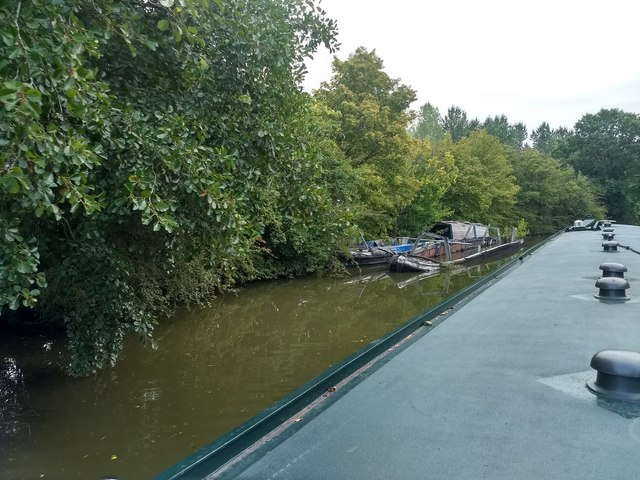 Derelict sunken canal boats on the Grand Union Canal