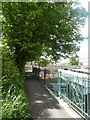 SX9193 : Railings and path overlooking Exeter Central Station by David Smith