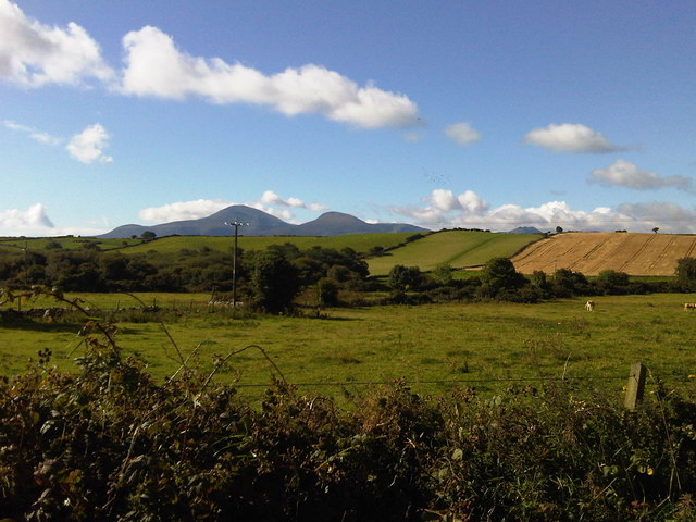 View across fields towards Mourne Mountains from Aghlisnafin road