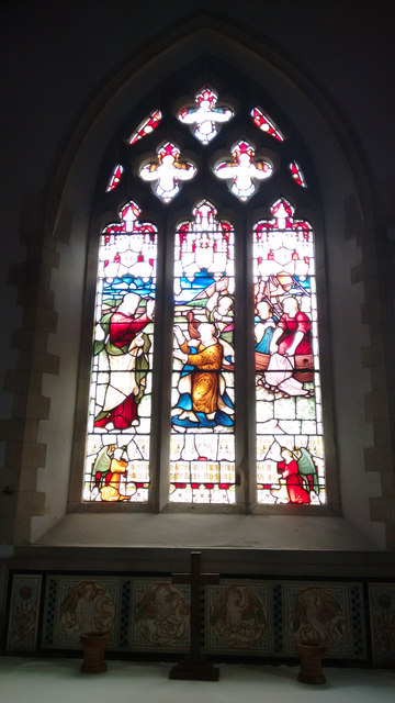 Stained glass window in Compton Church