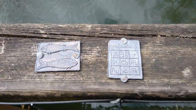 Strange plaques attached to footbridge over River Avon at Stareton