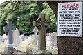 SO5923 : Sign in churchyard by John Winder