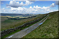 SD8384 : The Pennine Way takes the West Cam Road heading for Hawes by Andy Waddington