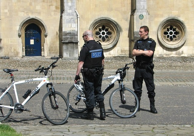 Two officers from the Bicycle Police Patrol and their cycles
