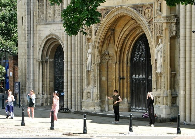 Group of people by Norwich Cathedral's west door