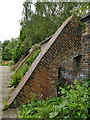 SE2632 : Western Flatts Cliff Park: flying buttresses in the rose garden by Stephen Craven