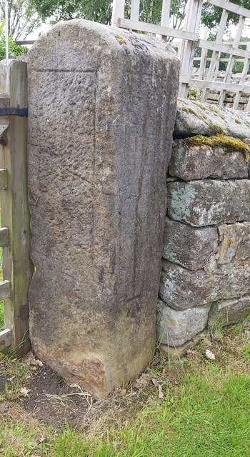 Fine Sandstone gatepost in Grantley with a Benchmark on