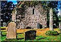 NS0195 : Ruin of Kilmorie Chapel with gravestones by Trevor Littlewood