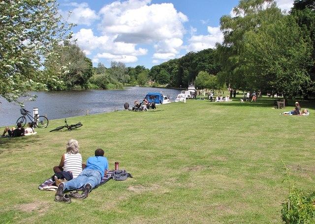 People enjoying the sunshine on Bramerton Common