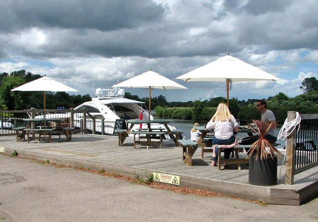 Outdoor seating area at The Water's Edge pub
