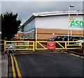 ST2995 : Yellow barrier near Asda, Cwmbran town centre by Jaggery