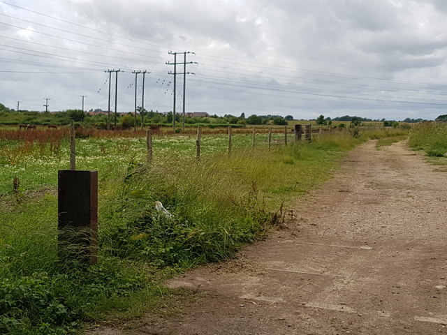 Track to solar farm and power lines