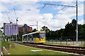 SJ8096 : Metrolink Tram, Trafford Wharf by David Dixon