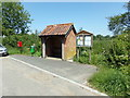TG1318 : Bus Shelter on School Road by Adrian Cable